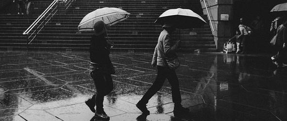 walking in the rain with umbrellas